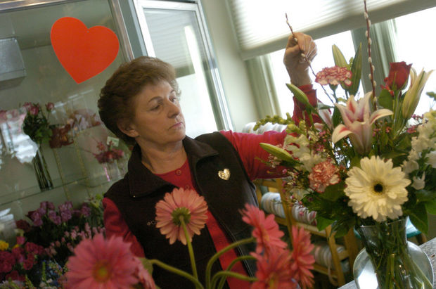 A floral designer arranges a bouquet at Dexter Flowers. (Eliyahu Gurfinkel | Ann Arbor News file photo)