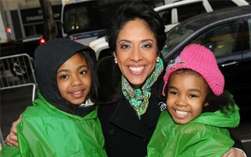 Anna Maria Chavez poses with two Girl Scouts