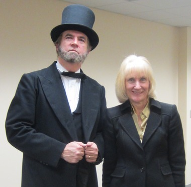Dressed in full Lincoln attire, Judge Ron Lowe poses with Joan Vestrand, associate dean at Cooley Law School. Photo Courtesy of Cooley Law School