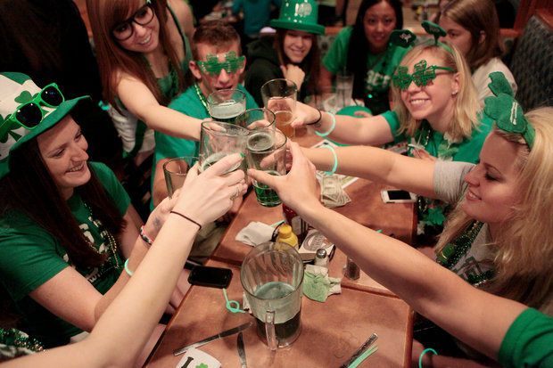 A group of friends commence a toast at the Brown Jug in Ann Arbor on St. Patrick's Day 2012. (Ann Arbor News file photo)