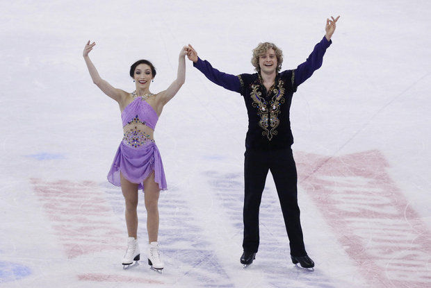 Meryl Davis, left, of Canton, and Charlie White, of Bloomfield Hills, skate together at the US Figure Skating Championships in Boston on Saturday, Jan. 11, 2014. The Michigan skaters are heading to the 2014 Winter Olympics in Sochi Russia to compete for Team USA. (Bizuayehu Tesfaye/AP Images for Puffs)