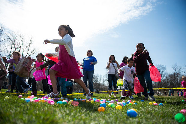 Children race to collect as many eggs as possible during the Jaycees' Easter Egg Scramble at Frog Island Park in Ypsilanti, Saturday, April 12, 2014. Courtney Sacco | The Ann Arbor News