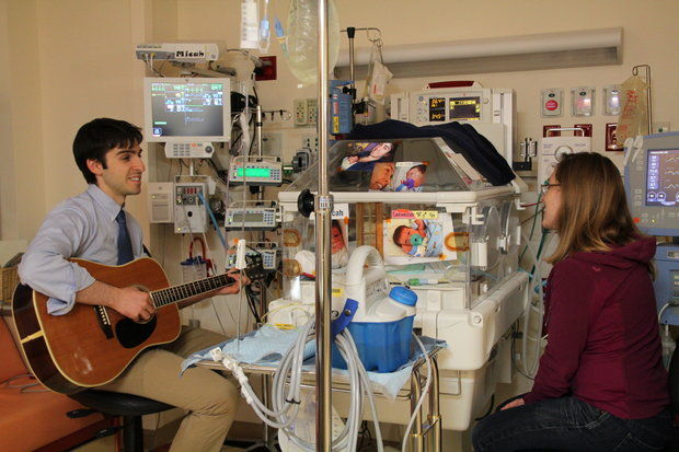 Jennifer and Noah Canvasser playing/singing for their son Micah in the neonatal intensive care unit in 2012 at C.S. Mott Children'€™s Hospital. (Family photo)
