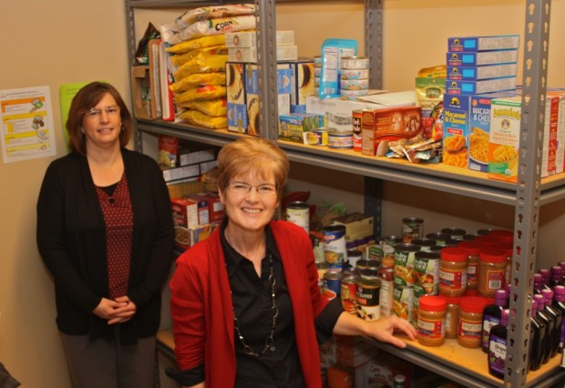 WCC Student Resource Center (SRC) Clerical Staff Member Colleen Ramsdell (left) and SRC Assistant Carol Tinkle ensure that the food pantry is always stocked. Photo by Lynn Monson